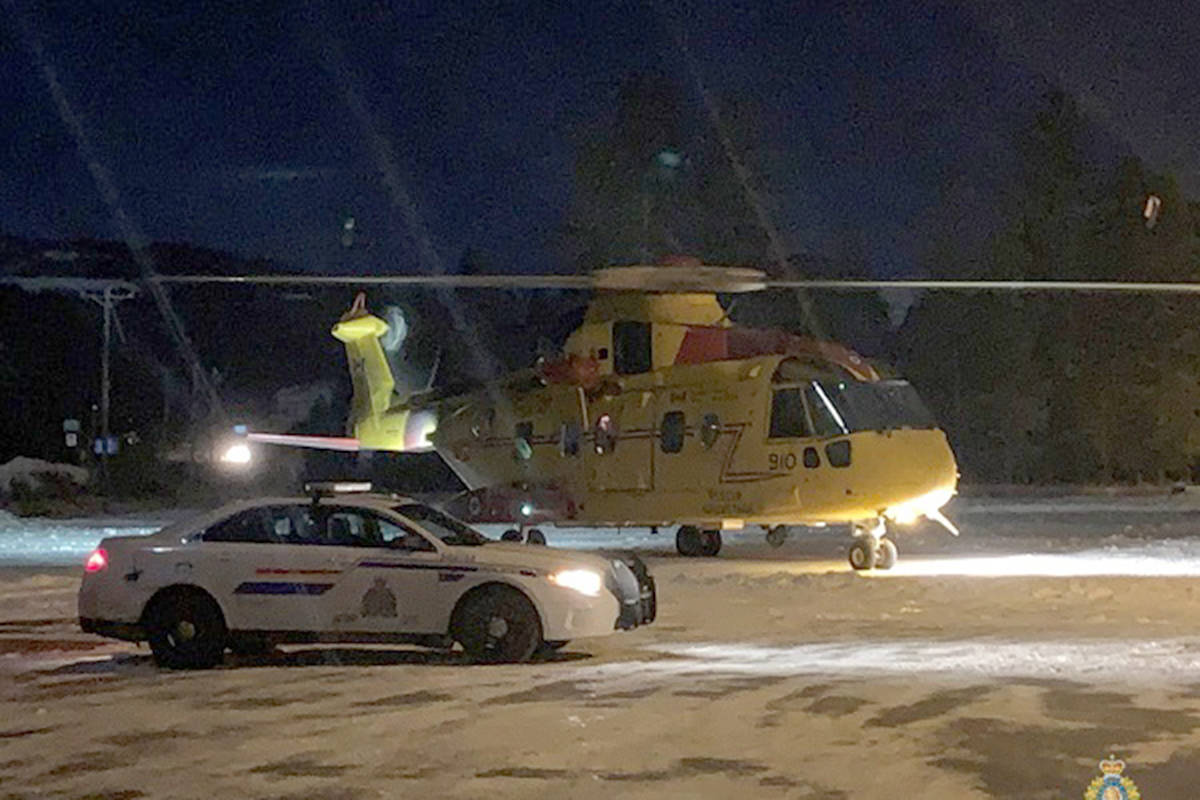 An RCMP cruiser looks on as a military search and rescue helicopter winds down near Bridesville, B.C. Tuesday, Dec. 1. Photo courtesy of RCMP Cpl. Jesse O'Donaghey
