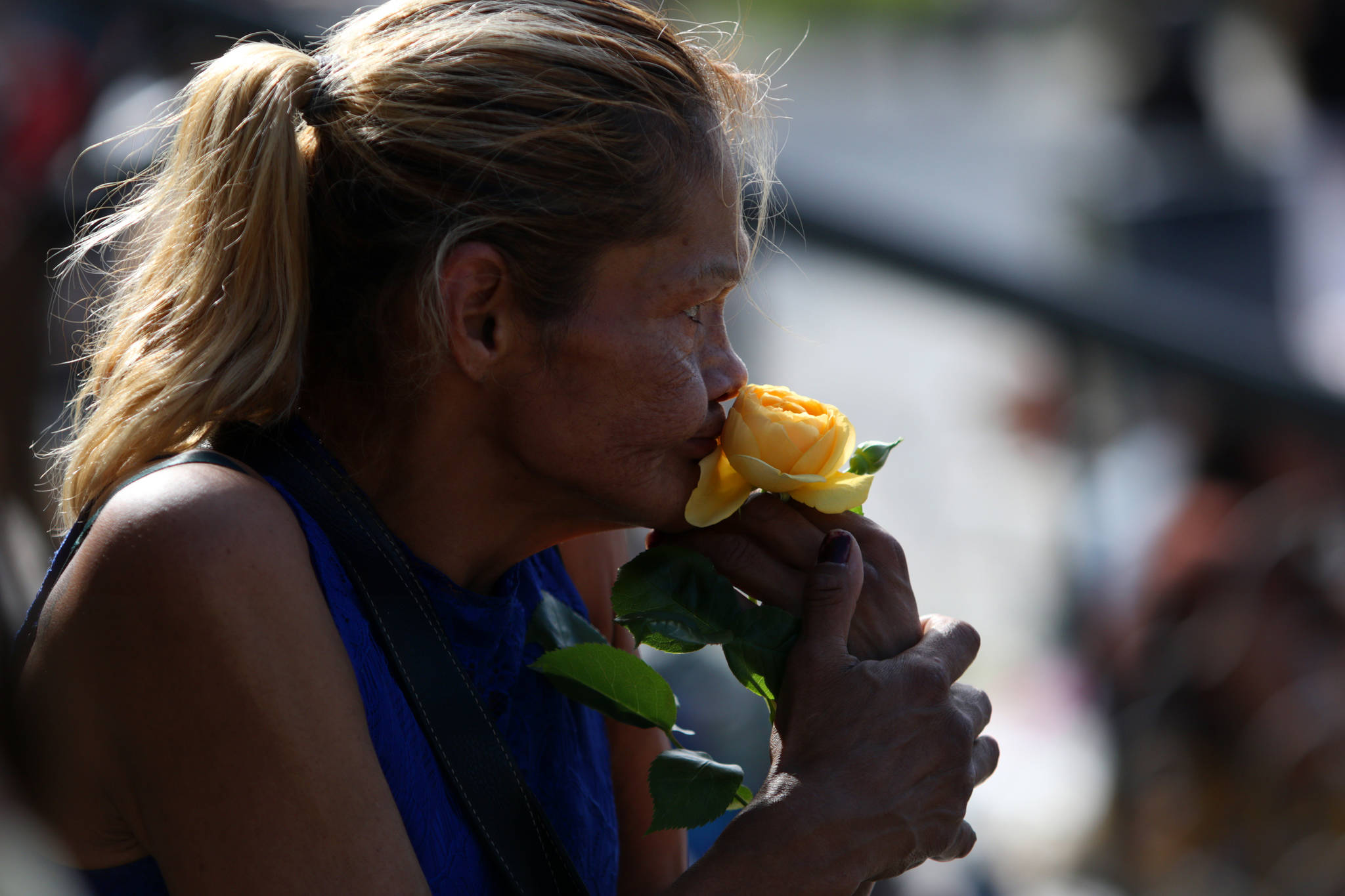 Catherine McCarthy-Martin holds a yellow rose in honour of her niece Chantel Moore during a healing gathering at the B.C. Legislature in Victoria on Thursday, June 18, 2020. THE CANADIAN PRESS/Chad Hipolito
